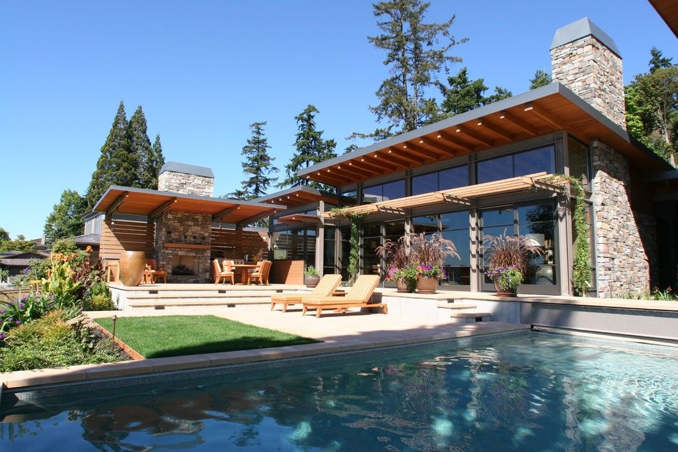 Roof Overhang for a Contemporary Exterior with a Landscape and Lake House One   Exterior by Mcclellan Architects