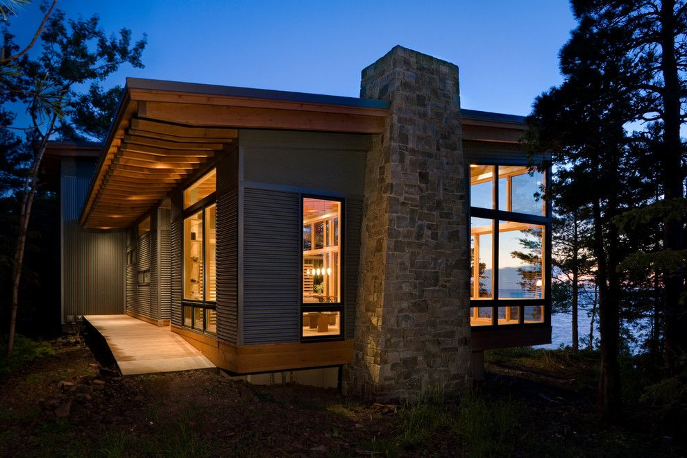 Roof Overhang for a Modern Exterior with a Rafters and Eagle Harbor Cabin by Finne Architects