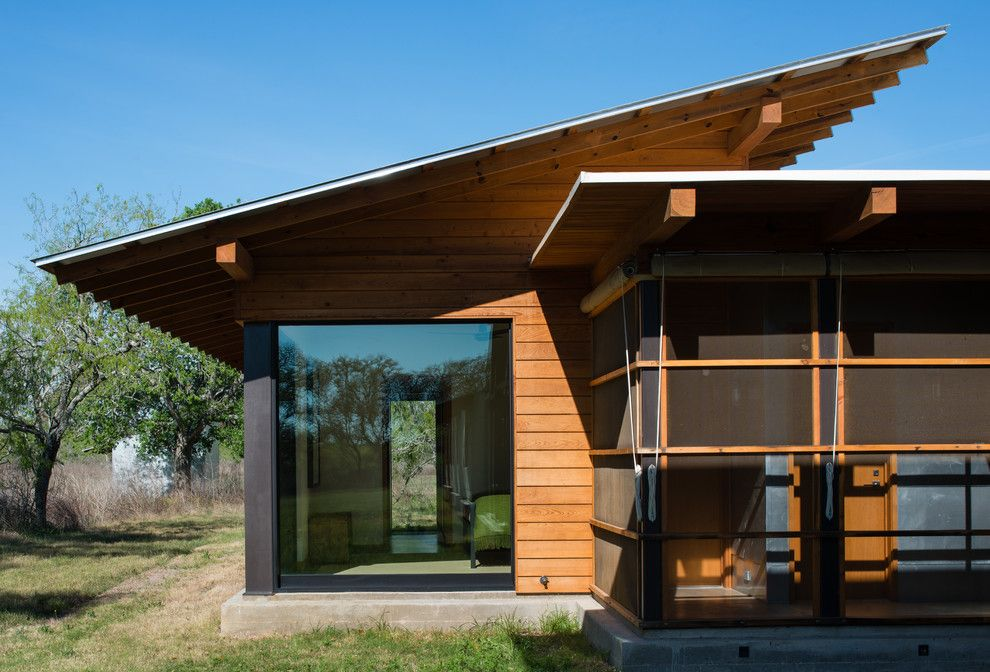 Roof Overhang for a Modern Exterior with a Screened Porch and Big Tree Camp by Progressive Solutions / Renaissance Bronze Windows