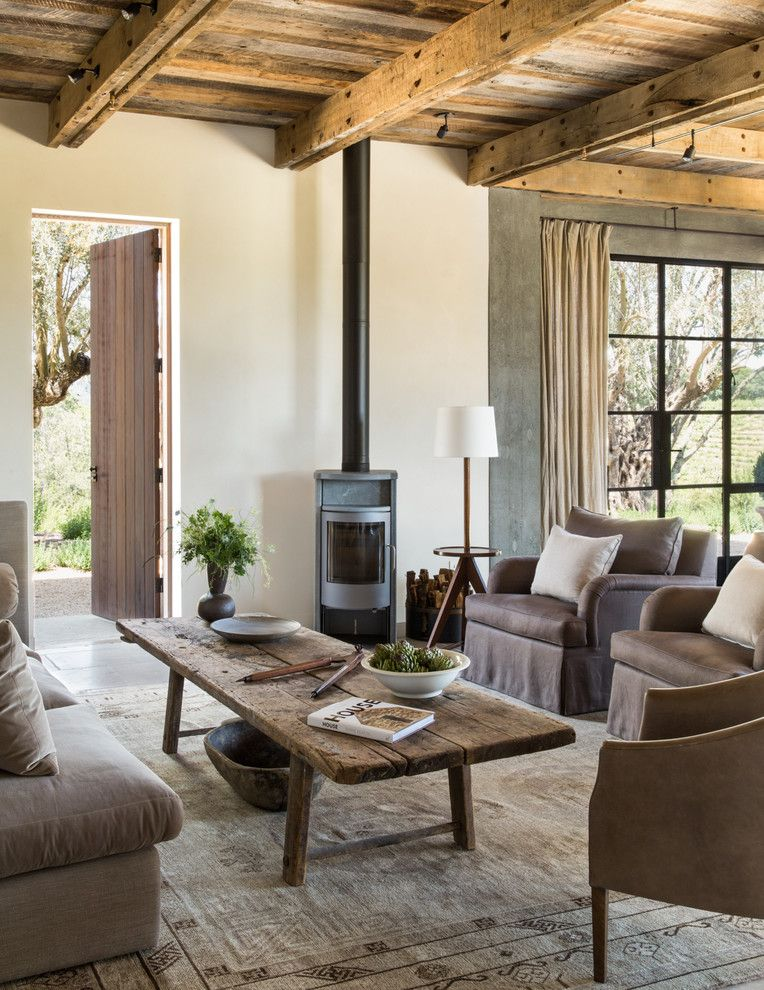 Rose Tarlow for a Farmhouse Living Room with a Beamed Ceiling and Healdsburg Ranch by Jute Interior Design