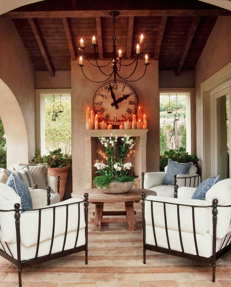 Rose Tarlow for a Shabby Chic Style Patio with a Arched Doorway and Wendi Young Design by Wendi Young Design