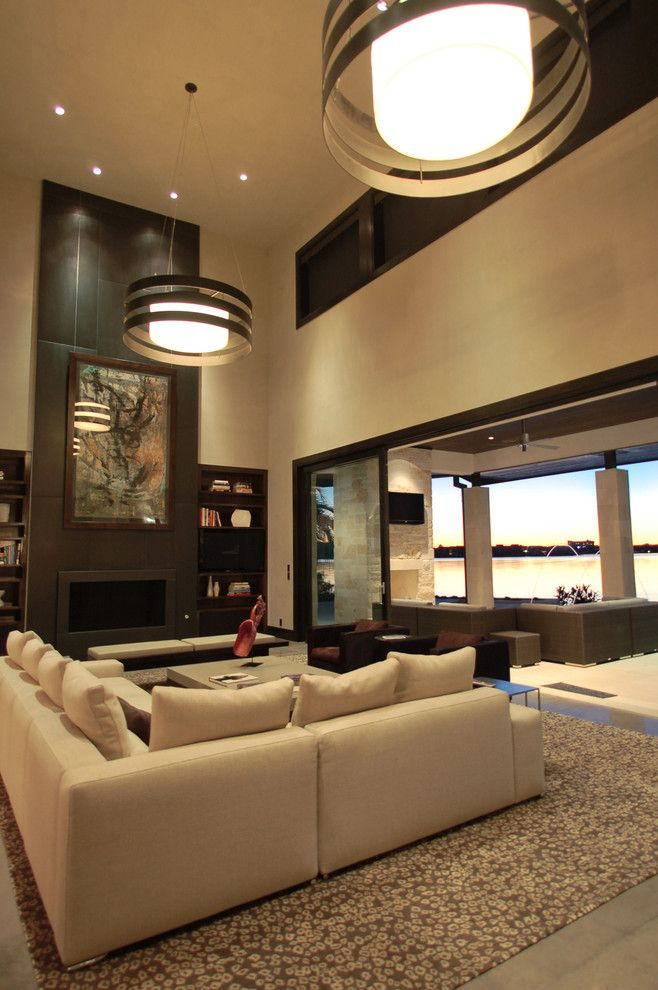 Rudy Furniture for a Contemporary Living Room with a Modern and Horseshoe Bay Lakehouse Living by Cornerstone Architects