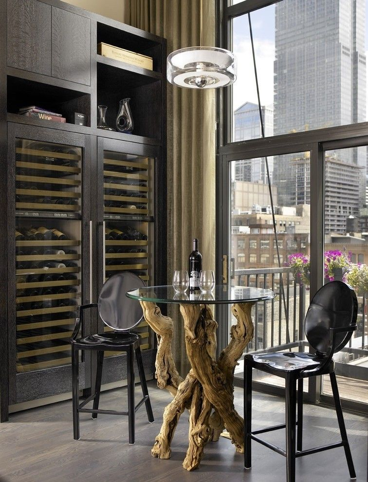 Rudy Furniture for a Industrial Wine Cellar with a Balcony and Jamesthomas, Llc by Jamesthomas Interiors