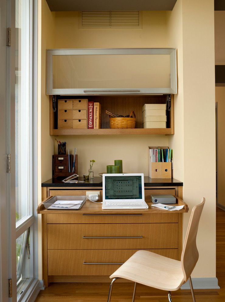 Rudy Furniture for a Midcentury Home Office with a Wood Floor and Mid Century Remodel by Lucy Johnson Interior Design