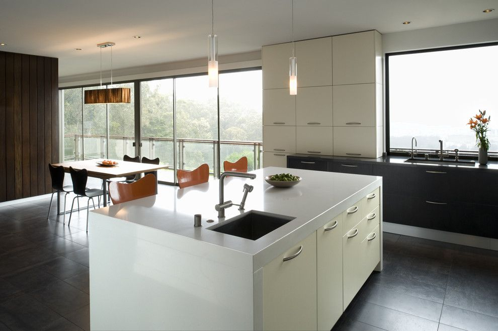 Rudy Furniture for a Modern Kitchen with a White Cabinets and Eberhart by John Lum Architecture, Inc. Aia
