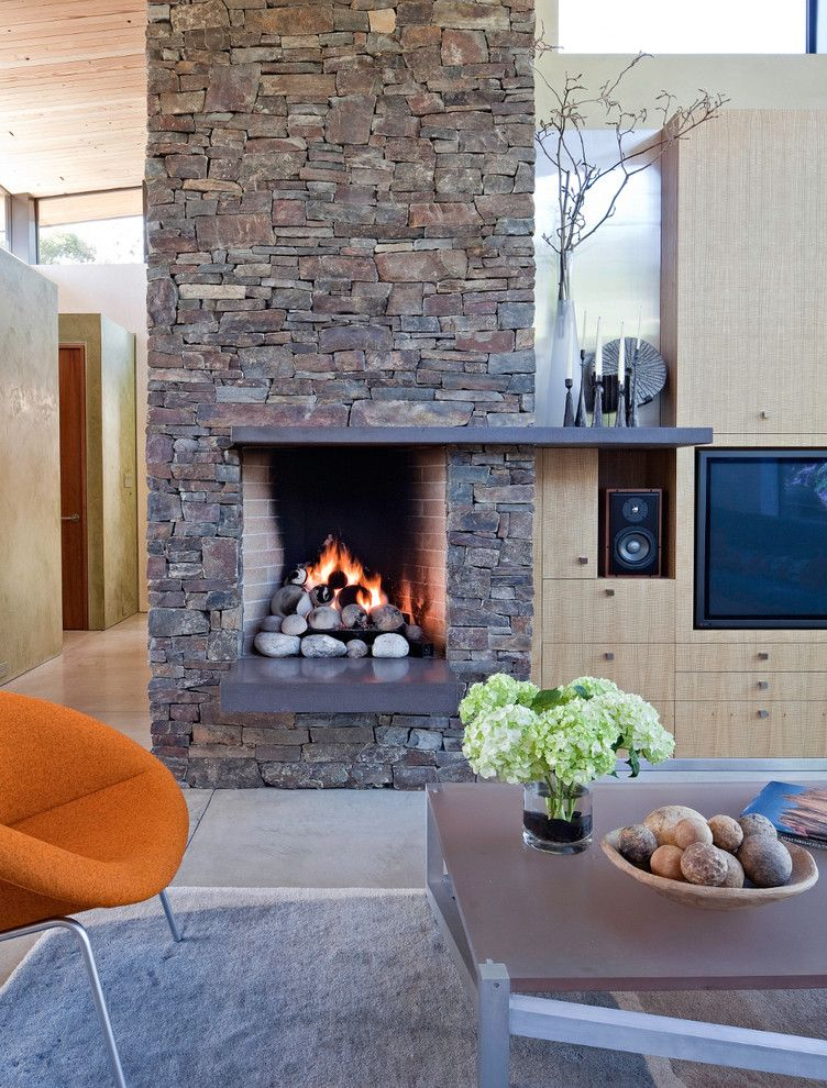 Rumford Fireplace for a Beach Style Living Room with a Pendant Light and Stinson Beach House by Wa Design Architects
