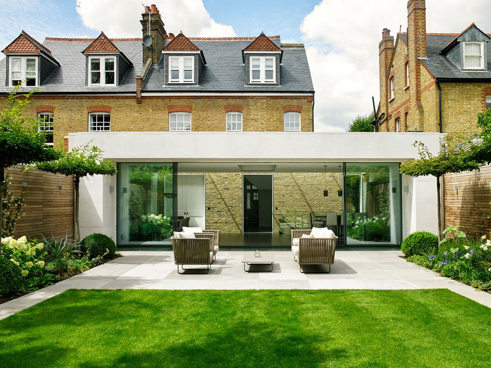 Ryan Lawn and Tree for a Contemporary Patio with a Fence and Wandsworth Contemporary Bespoke Grey Kitchen by Brayer Design