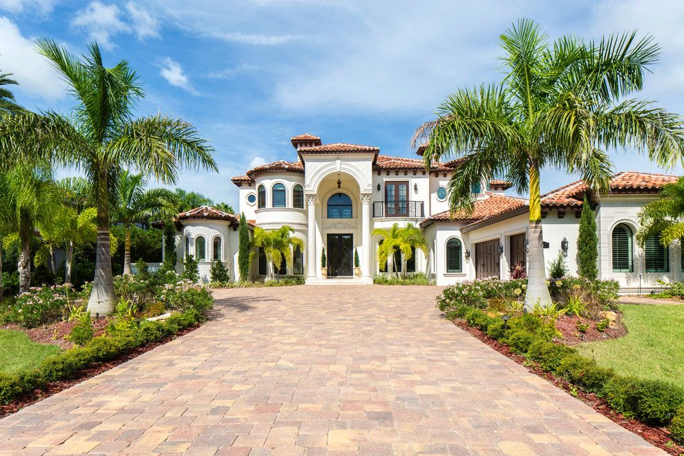 Ryland Homes Reviews for a Mediterranean Exterior with a Arched Windows and Lansing Island Home by Echelon Builders