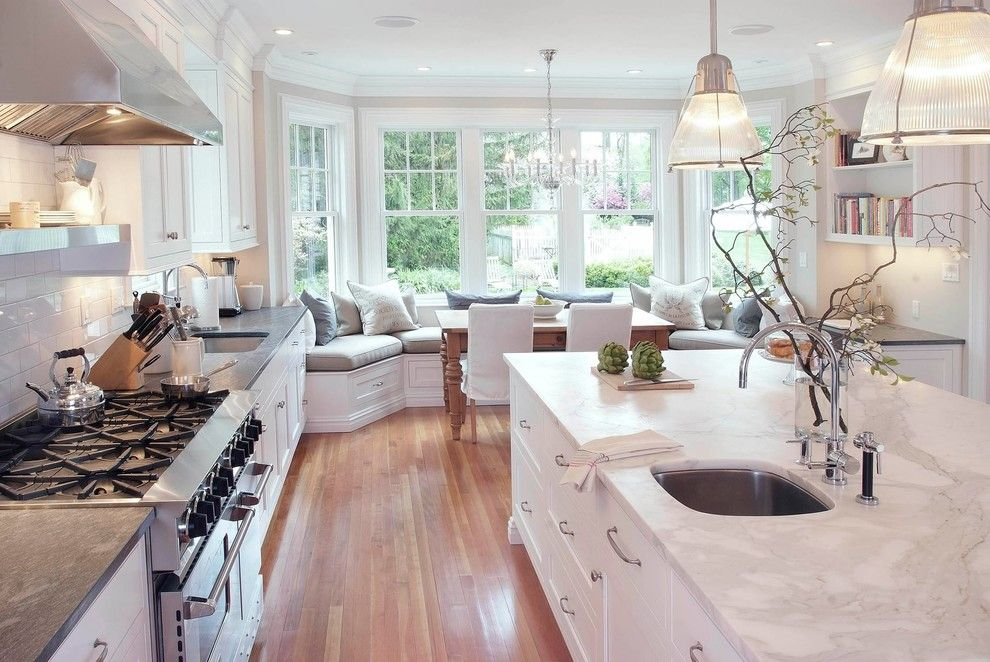 Ryland Homes Reviews for a Traditional Kitchen with a Subway Tile Backsplash and Classical Kitchen by Pickell Architecture