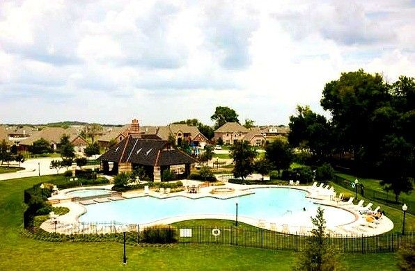 Sandlin Homes for a Traditional Pool with a Community Pool and Country Lakes Community   Argyle, Texas by Sandlin Custom Homes