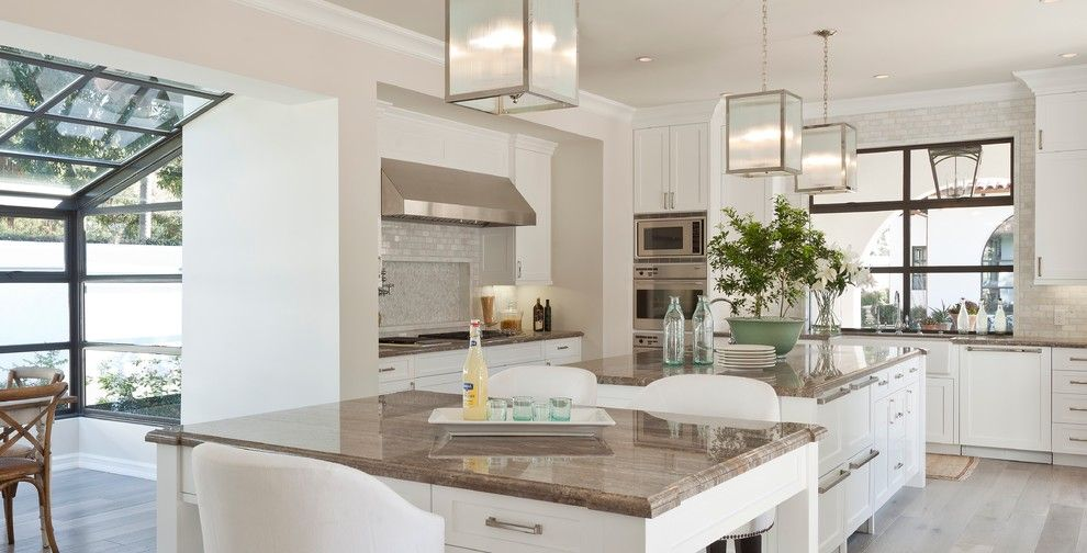 Santa Cecilia Light Granite for a Mediterranean Kitchen with a Glass Ceiling and Santa Monica by Sinclair Associates Architects
