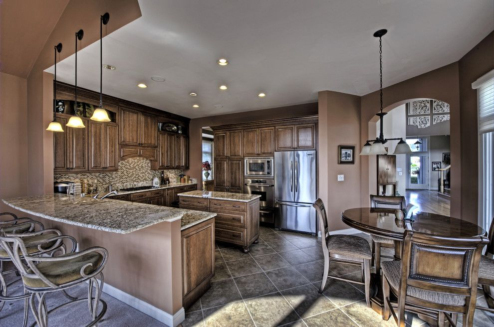 Santa Cecilia Light Granite for a Traditional Kitchen with a Double Oven and Leesburg Traditional Kitchen   Seating by Synergy Design & Construction