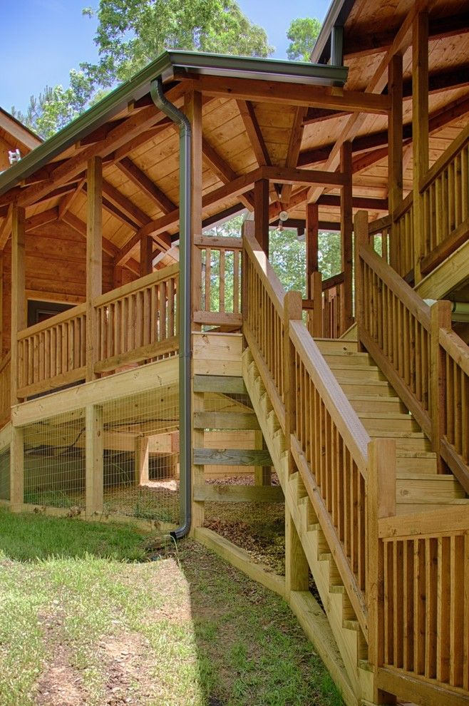 Satterwhite Log Homes for a Rustic Spaces with a Railing and Modified Misty Ridge   Ellijay, Ga by Satterwhite Log Homes