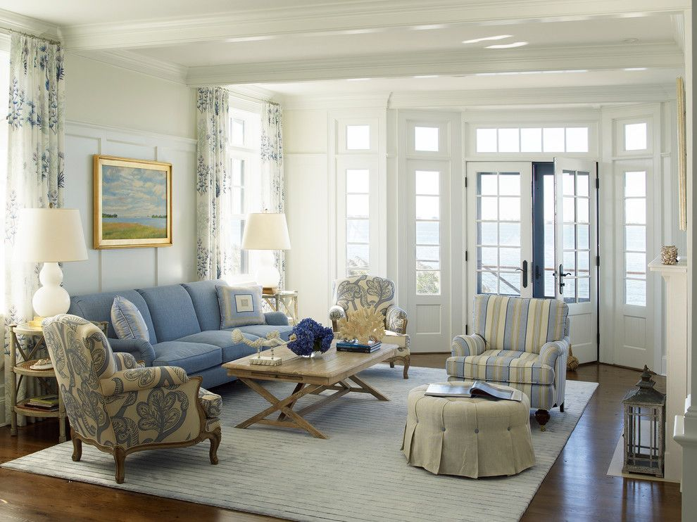 Schewels Furniture for a Beach Style Living Room with a Transom Window and Nautical House on the Bay   Hamptons by Austin Patterson Disston Architects