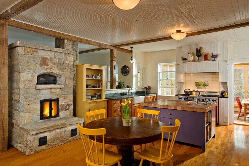 Schewels Furniture for a Farmhouse Kitchen with a Stone Fireplace and Leed Platinum Home by Phinney Design Group