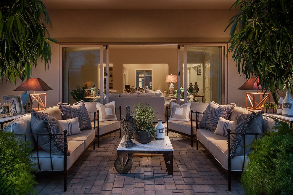Schewels Furniture for a Mediterranean Patio with a Indoor Outdoor Living and Camelot Reserve by Camelot Homes