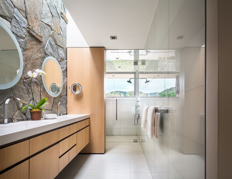 Schmitt Furniture for a Contemporary Bathroom with a Stone Wall and Guest Bath by Studio Bracket