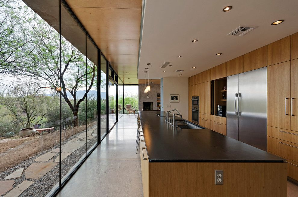 Schmitt Furniture for a Modern Kitchen with a Double Sided Island and Camino De Oeste Residence by Repp + Mclain Design and Construction