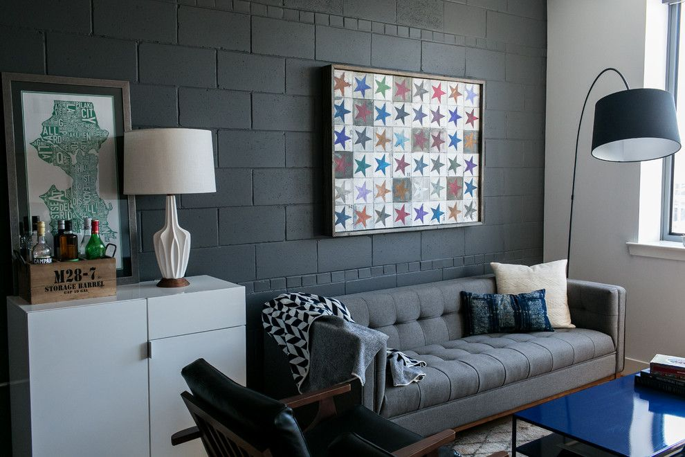 School House Electric for a Industrial Living Room with a Black Accent Wall and Alex's Condo by Residents Understood