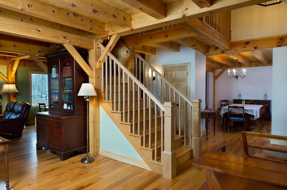 Schroder House for a Rustic Staircase with a Exposed Rafters and Timber Frame Custom Home Scotia,, New York by Bellamy Construction