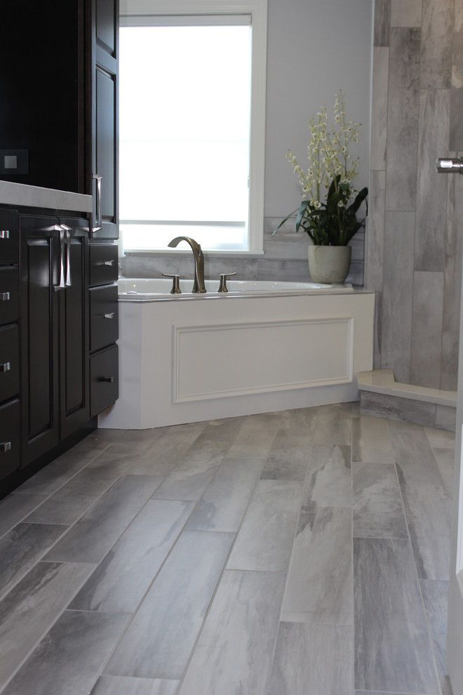 Sedlak Interiors for a Modern Bathroom with a Tile Floor and Falling Water Porcelain Tile Collection by Best Tile