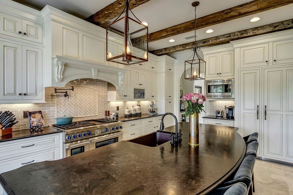 Sensa Granite for a Contemporary Kitchen with a Rounded Countertop and Bevolo Gas and Electric Lights by Bevolo Gas and Electric Lights