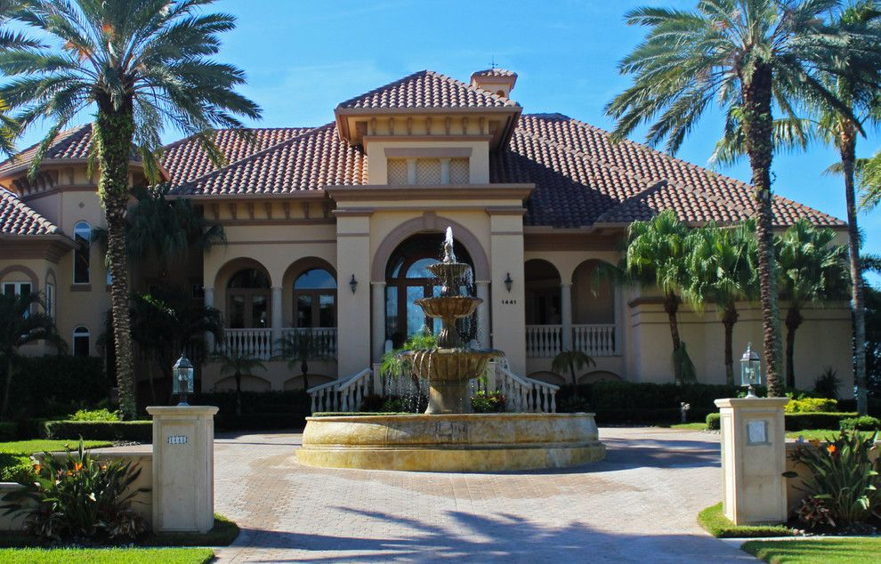 Shaddock Homes for a Tropical Exterior with a Driveway and Italian Marble by Italian Marble, Llc