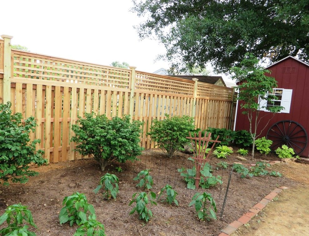 Shadowbox Fence for a Contemporary Exterior with a Lattice Fence and Western Red Cedar Shadowbox with Lattice Top by the Fence Experts