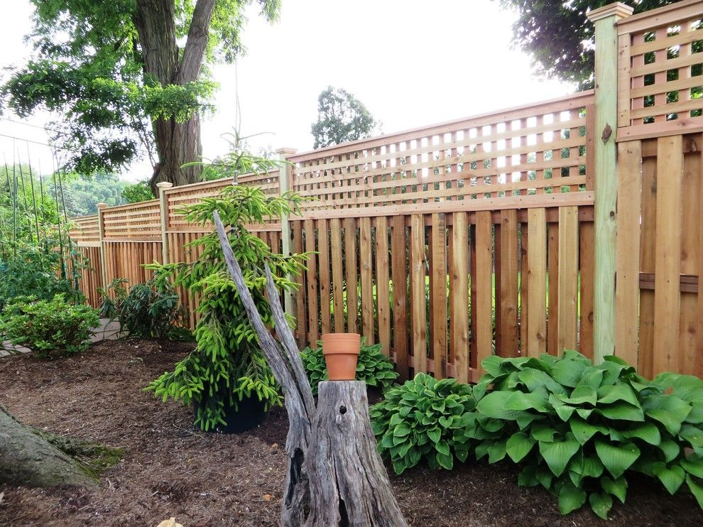 Shadowbox Fence for a Contemporary Exterior with a Picket Fence and Western Red Cedar Shadowbox with Lattice Top by the Fence Experts