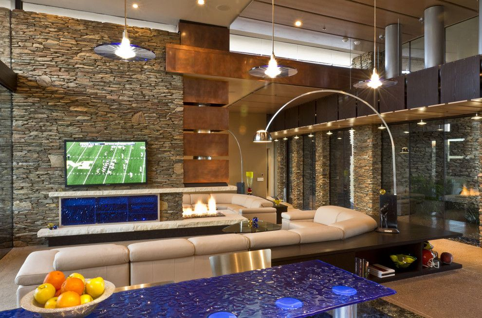 Shea Homes Az for a Southwestern Living Room with a Stone Wall and Sefcovic Residence by Tate Studio Architects
