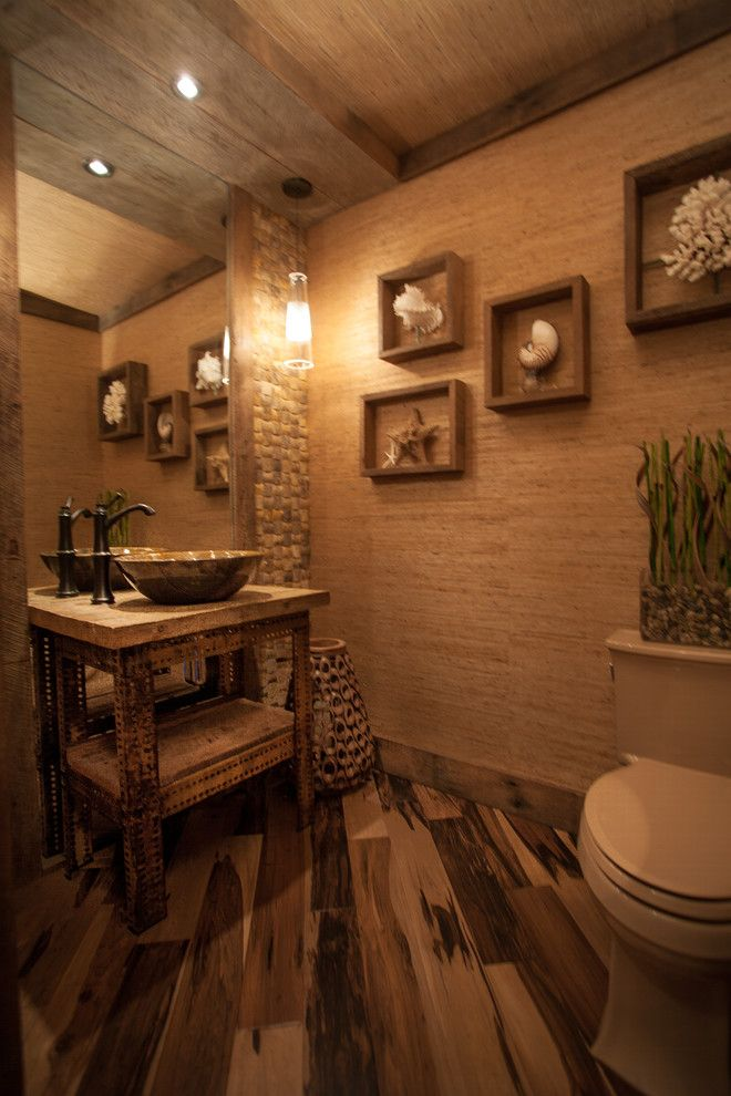 Shell Lumber for a Rustic Powder Room with a Pendant Lights and Gilles Res. by Select Builders