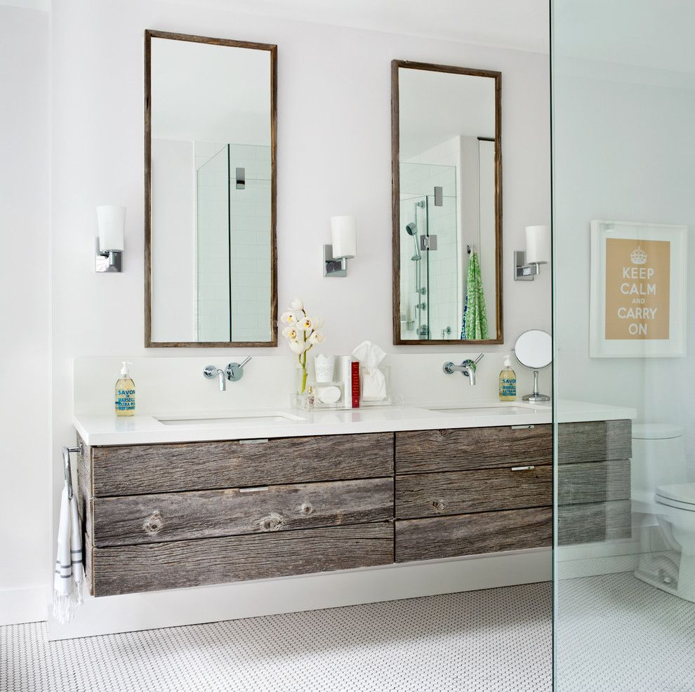 Shell Lumber for a Transitional Bathroom with a Distressed Wood Floating Cabinets and City Homes by Jennifer Worts Design Inc.