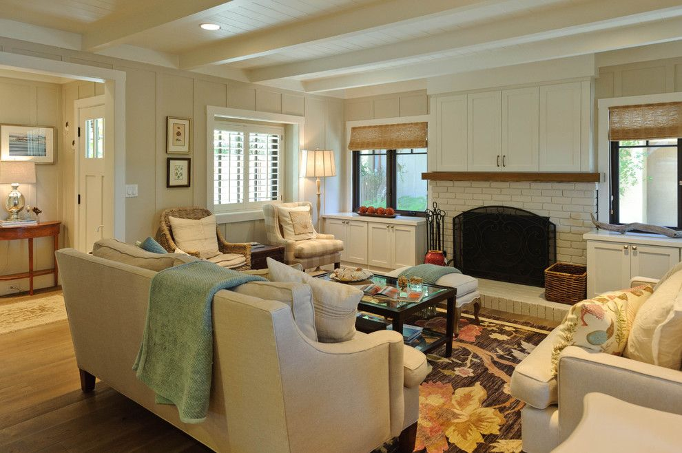 Sherwin Williams Alabaster for a Beach Style Living Room with a Fireplace and Carmadillo Living Room by Regan Baker Design