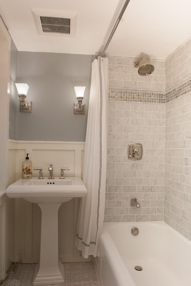 Sherwin Williams Alabaster for a Farmhouse Bathroom with a Glass Tile and Marble Bathroom by Ngd Interiors, Inc