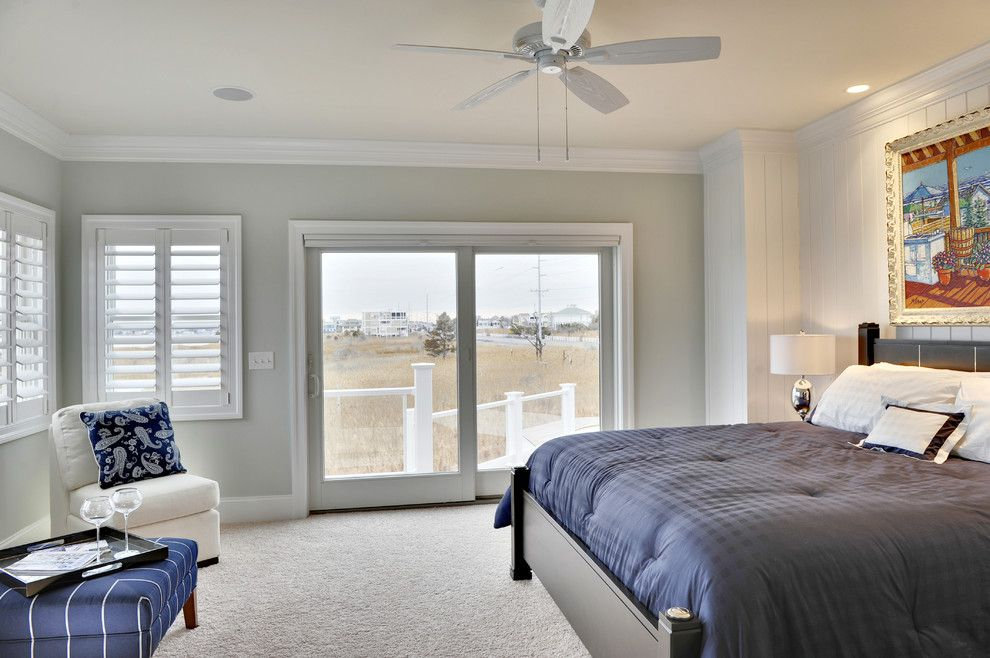 Sherwin Williams Alpaca for a Beach Style Bedroom with a Wood Trim and Owner's Bedroom by Echelon Custom Homes