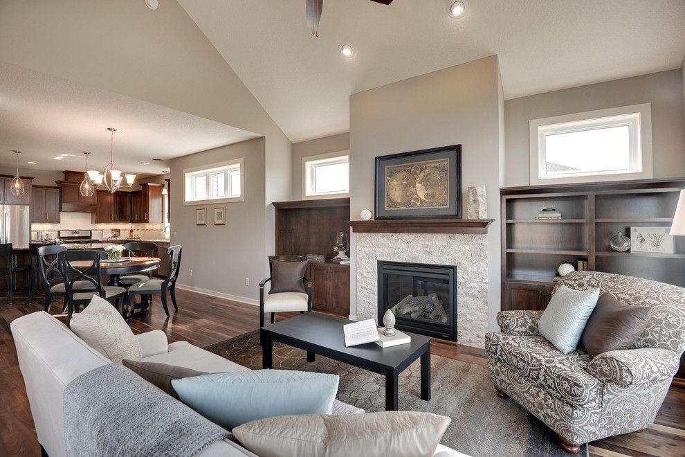 Sherwin Williams Alpaca for a Transitional Living Room with a Vaulted Ceiling and the Trillium Ii by Iverson Homes