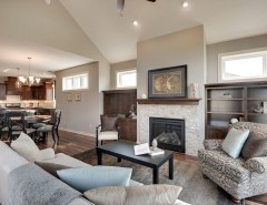 Sherwin Williams Amazing Gray for a Transitional Living Room with a Transom Windows and the Trillium II by Iverson Homes