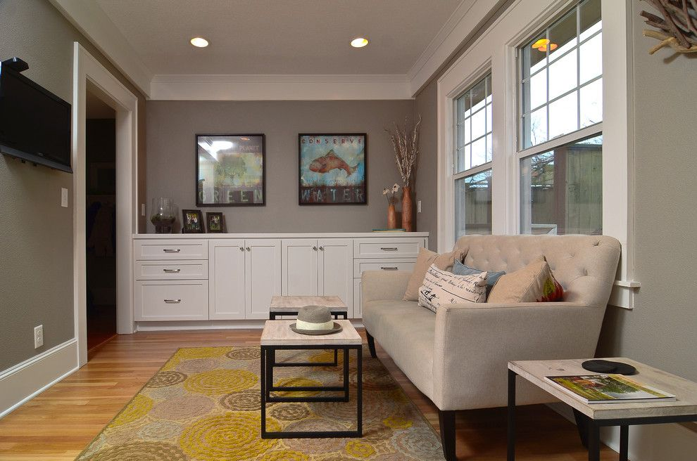 Sherwin Williams Dorian Gray for a Contemporary Family Room with a Tufted Sofa and Form and Function by Mountainwood Homes