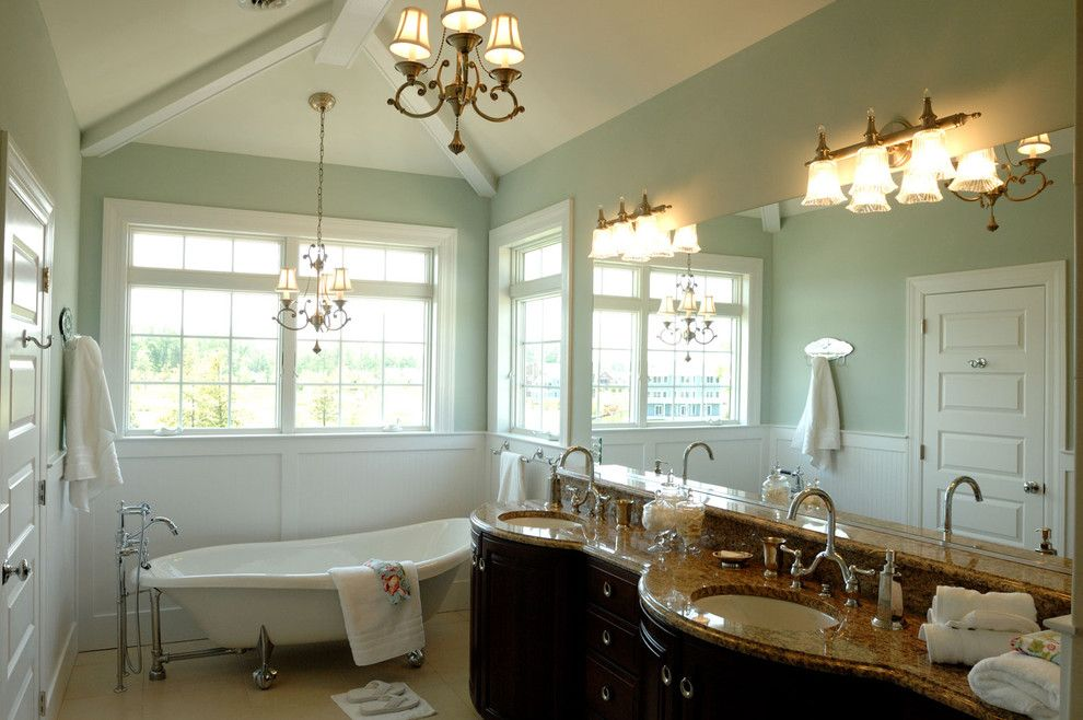 Sherwin Williams Dover White for a Traditional Bathroom with a Dark Wood Cabinets and Owner's Bath by Echelon Custom Homes