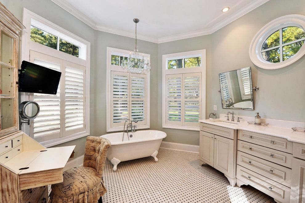 Sherwin Williams Dovetail for a Beach Style Bathroom with a Double Sinks and Owners Bath by Echelon Custom Homes