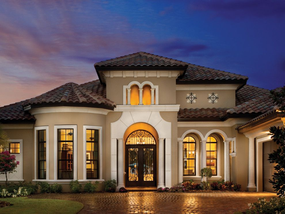 Sherwin Williams Exterior Paint Colors for a Mediterranean Exterior with a Brick Paving and Valencia 1180 by Arthur Rutenberg Homes