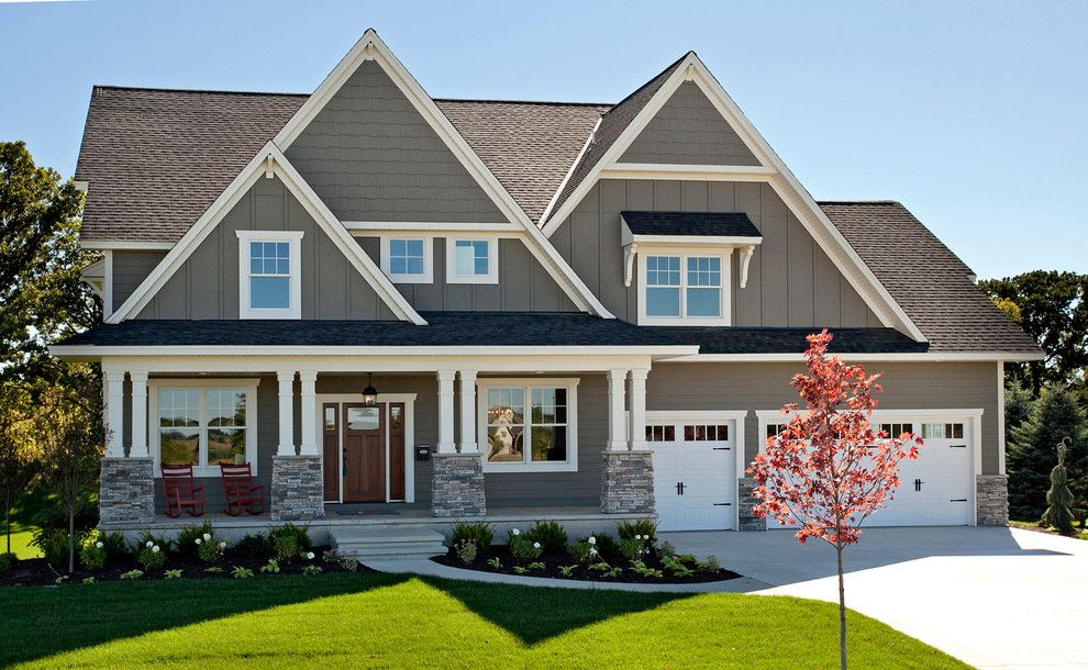 Sherwin Williams Exterior Paint Colors for a Traditional Exterior with a Three Car Garage and 2014 Spring Parade of Homes by Hart's Design