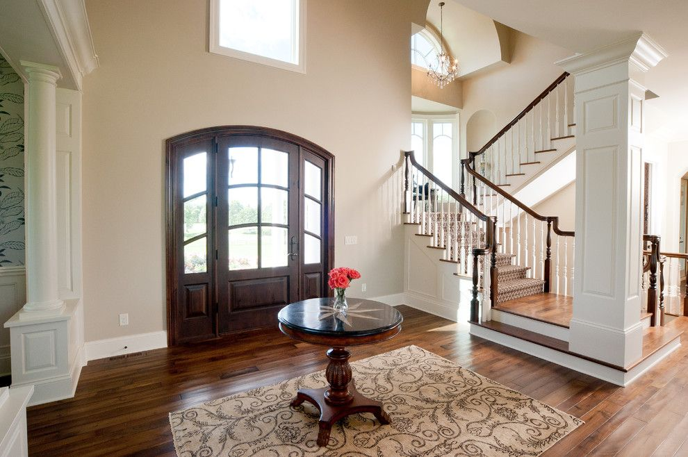 Sherwin Williams Kilim Beige for a Traditional Entry with a Column and Medina Luxury Home by Schrader & Companies