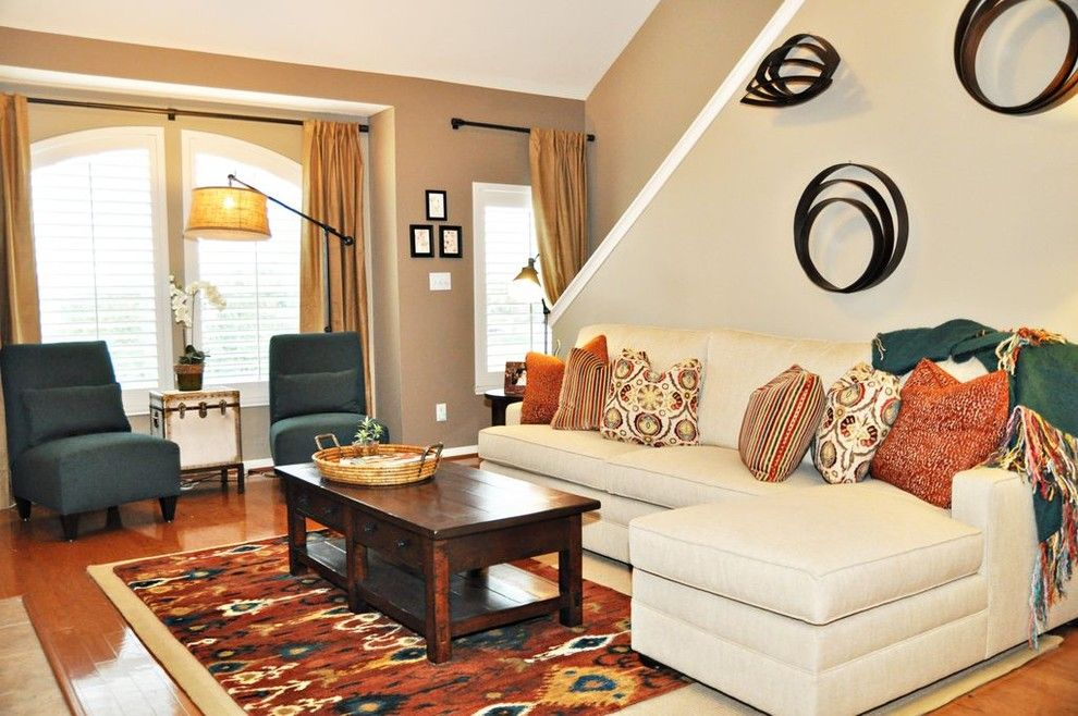 Sherwin Williams Kilim Beige for a Traditional Living Room with a Circular Wall Art and Cs Townhome by Purdy Designs Llc