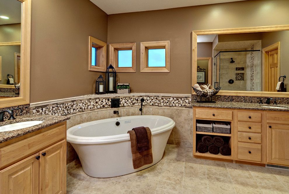 Sherwin Williams Latte for a Contemporary Bathroom with a Large Mirror and Master Bath by Lori Handberg Designs