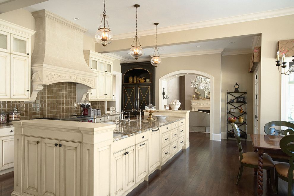 Sherwin Williams Macadamia for a Traditional Kitchen with a Chandelier and Kitchen View of the Island From the Sitting Area by Erotas Building Corporation