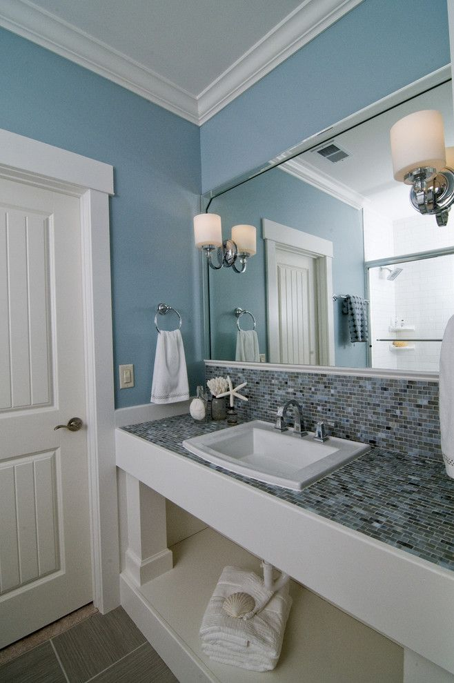 Sherwin Williams Pure White for a Beach Style Bathroom with a Open Shelves and Coastal Retreat Guest Bath by Southern Studio Interior Design