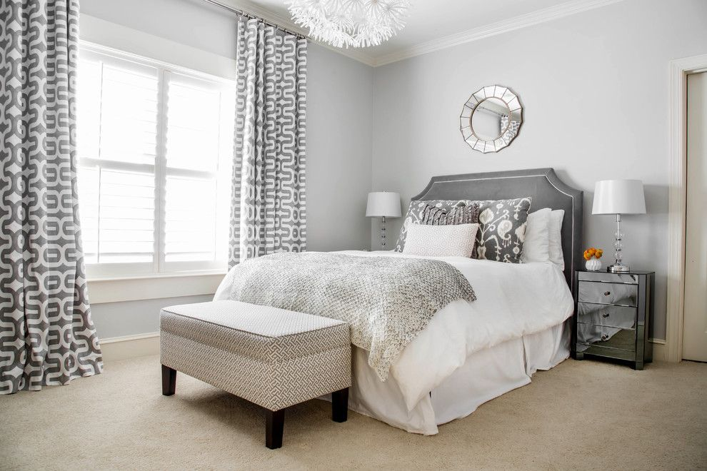 Sherwin Williams Repose Gray for a Transitional Bedroom with a Round Mirror and Bedrooms by Lindsey Binz Home Company