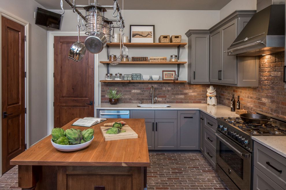 Sherwin Williams Repose Gray for a Transitional Kitchen with a Hanging Pots Rack and Central Texas Custom Home by Dawn Hearn Interior Design