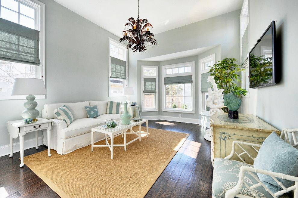 Sherwin Williams Sea Salt for a Beach Style Family Room with a Light Blue Walls and Silver Lake   Sunroom by Echelon Custom Homes